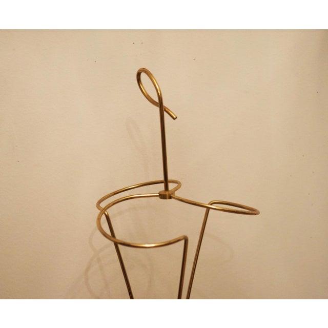 Vienna umbrella is made of cast iron with brass.