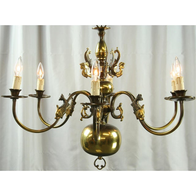 This high-quality metal chandelier dates to 1950s Belgium and features a gallery of whimsical mermaids! Crafted in the...