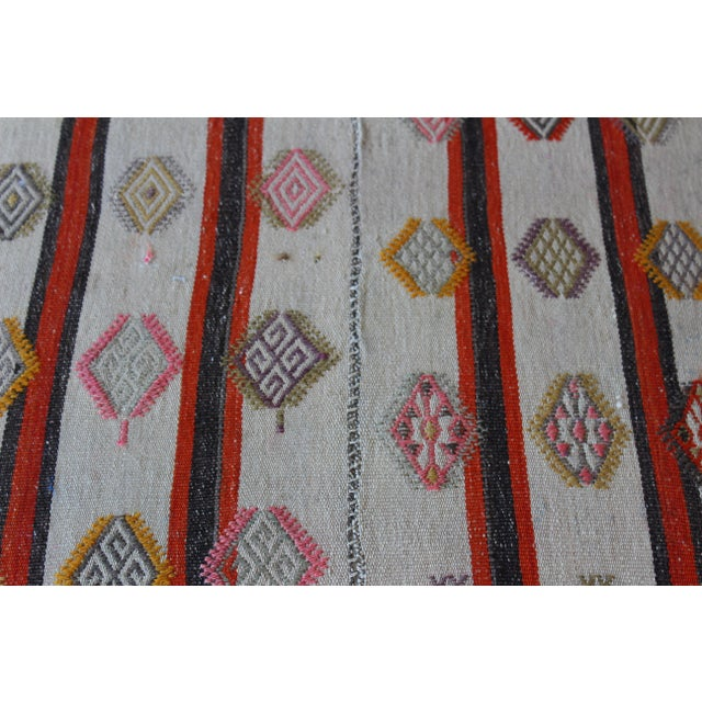 Ottoman Upholstered in a Vintage Rug For Sale - Image 4 of 10