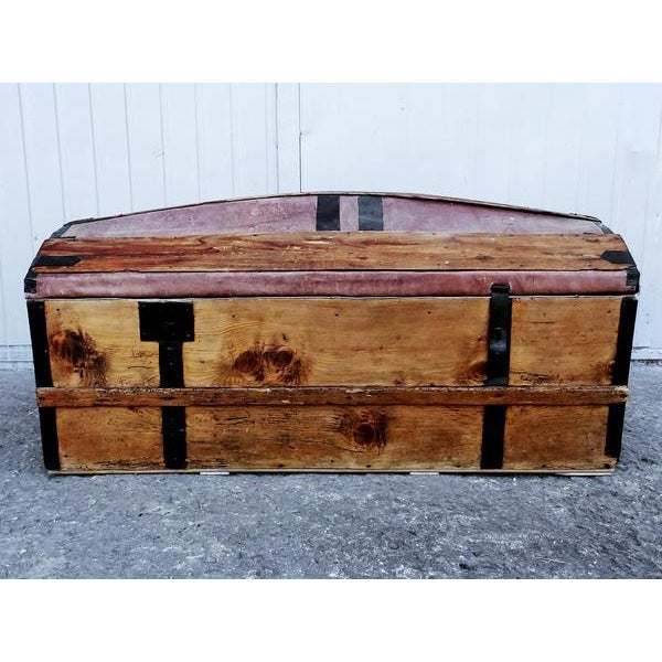Solid French Storage Trunk with Rare Leather Inserts on top Dimensions: W 39.5 in x D 18.75 x H 17.25 in Condition:...