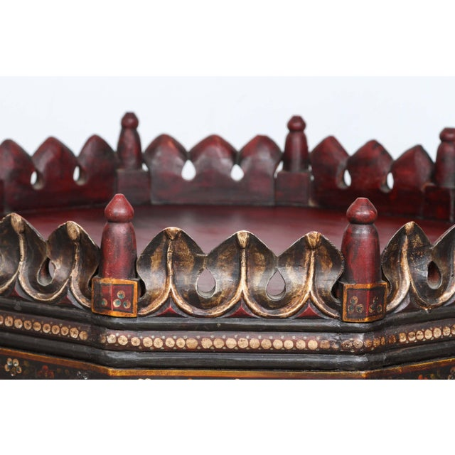 Exquisite rare Anglo Indian hand-painted teak coffee table. Top is red wine color, dark green and yellow tones. Solid top...