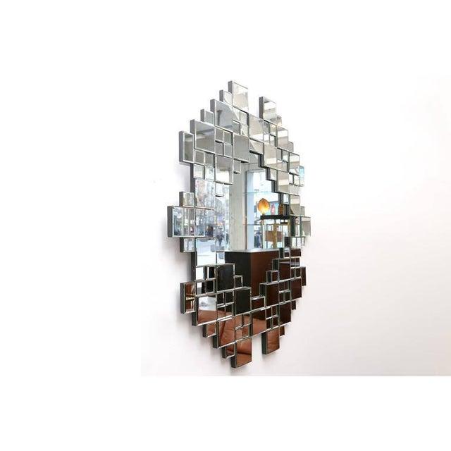 Multi Faceted Cubist mirror, USA, 1970s. H 120 cm W 87 cm.