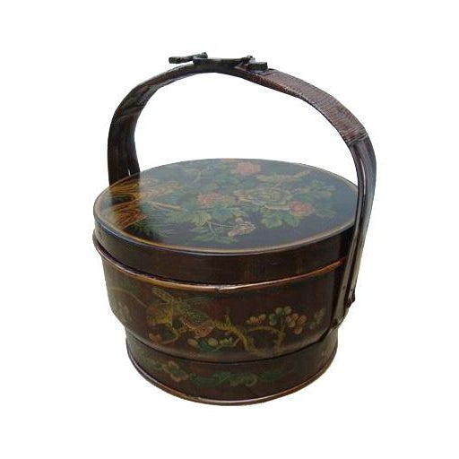 This is a traditional oriental bamboo basket with nice hand painted flower grahic on the lid. It has subtle color and...