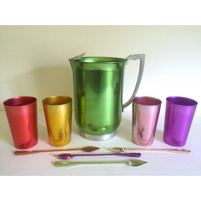 This vintage Mid Century Modern rare anodized spun aluminum multicolor nine piece beverage serving set is an incredibly...