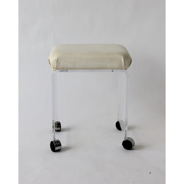 """Vintage lucite and leather rolling stool. Acrylic is .5"""" thick. Rolls easily and is very sturdy. White leather upholstery..."""