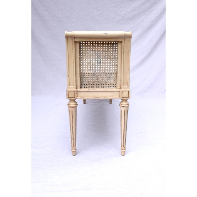 Louis XVI-style caned scroll-arm bench with a solid mahogany frame & floral relief details. Fully restored with newly...