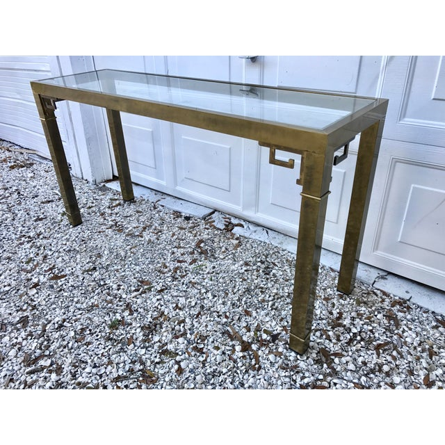 """Vintage Hollywood Regency brass and glass console table with Greek key detail. No makers mark, has """"Made in Italy"""" sticker..."""