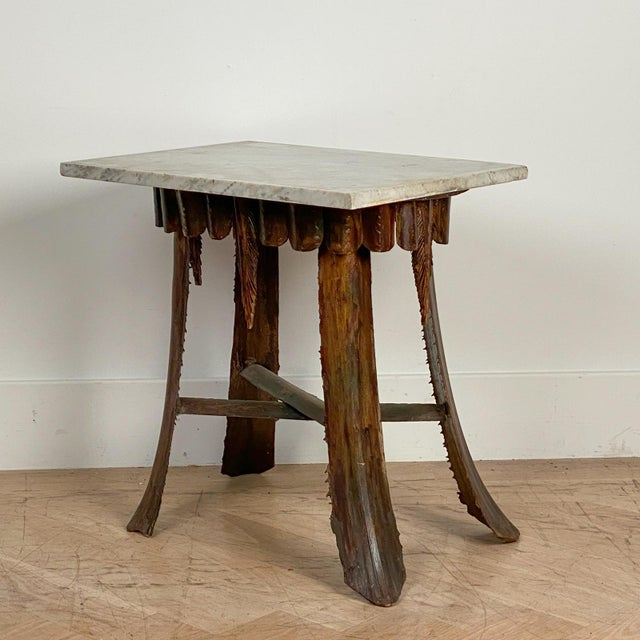 A mid Century Hawaiian palm leaf table with an antique marble top.