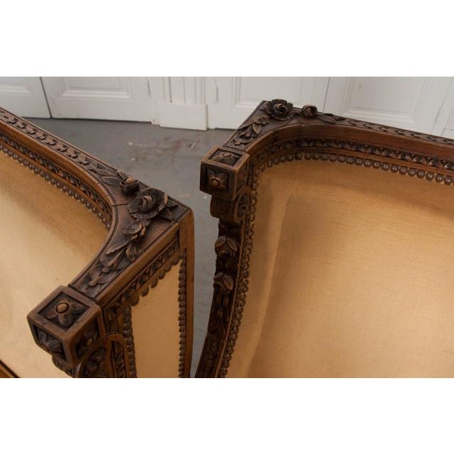 French 19th Century Louis XVI Carved Walnut Bergères - a Pair For Sale In Baton Rouge - Image 6 of 12