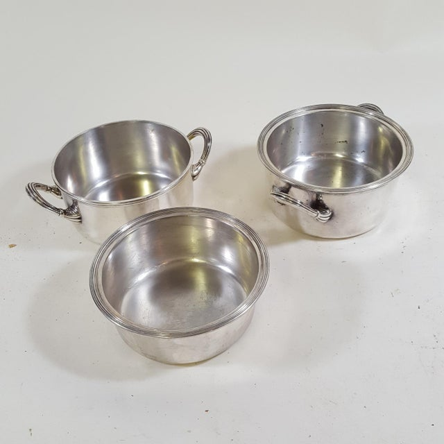 These two English silver plate warming serving dishes have a very art deco style. The top dish lifts out to allow hot or...