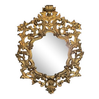 An Exuberant Italian Rococo Revival Carved Gilt-Wood Mirror For Sale