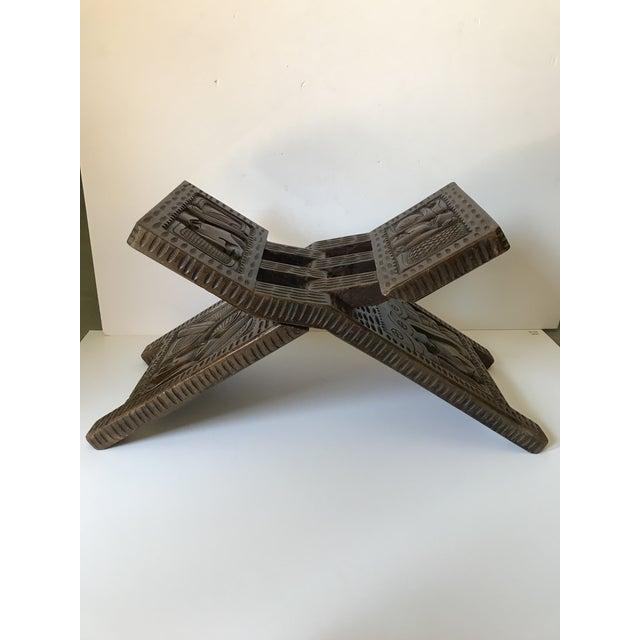 Antique ornately hand carved wooden folding stool made in Honduras Central America. It folds low or high and can be used...