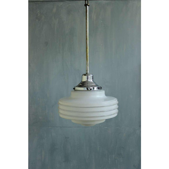 French, 1930s suspended ceiling fixture with frosted and clear glass bands.