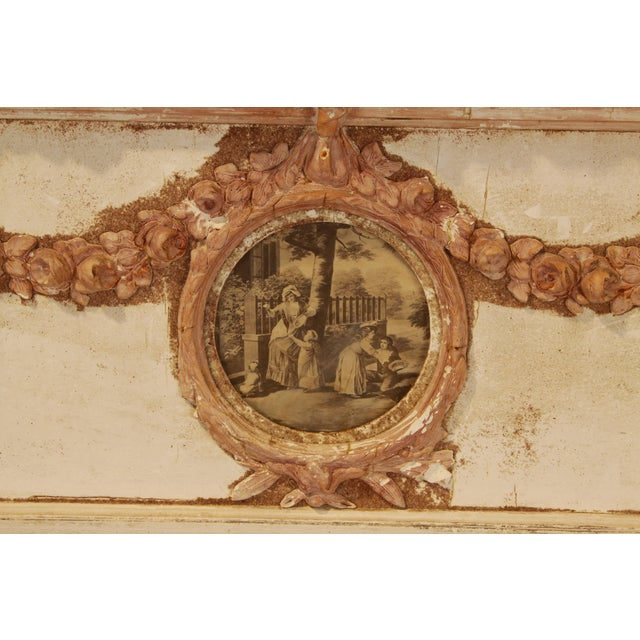 Exquisite painted, hand carved French trumeau from the 19th century. Mirror is in a cream finish, with terra cotta colored...