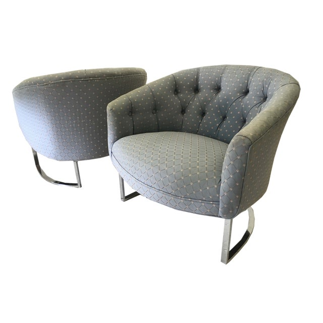 A pair of classic 1970s chairs in excellent condition, save for the traditional upholstery fabric someone chose in it's...