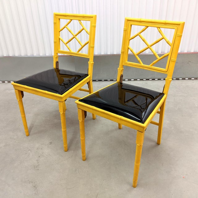 Pair of Hollwyood Regency style Faux Bamboo folding chairs from Leg O Matic, circa 1971. The chairs are bright yellow...