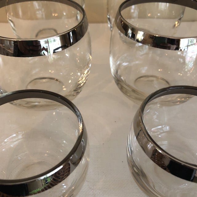 Beautiful collection of 6 Dorothy Thorpe glasses silver rimmed, perfect for any bar.