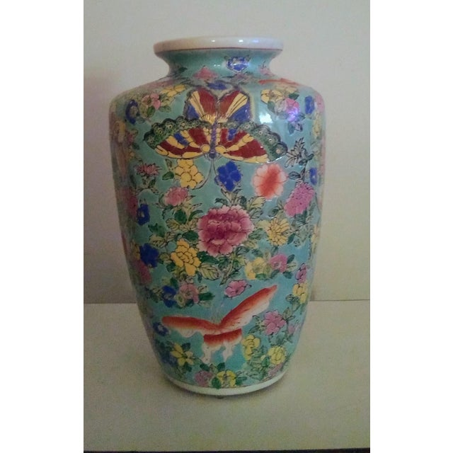 This beautiful porcelain vase features a butterfly and floral motif in vibrant colors all on a stunning turquoise back...