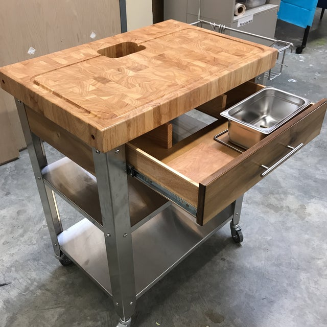 Chris & Chris Stadium work station. With thick end grain cutting board surface featuring stainless steel legs and shelves....