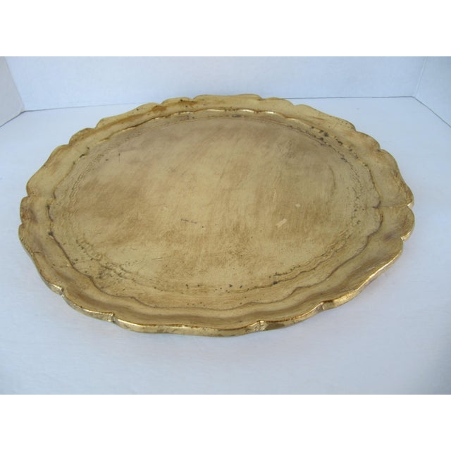 Beautiful gold tray with scalloped edges, made in Italy. Perfect for your vanity, to serve drinks or to use for candles.