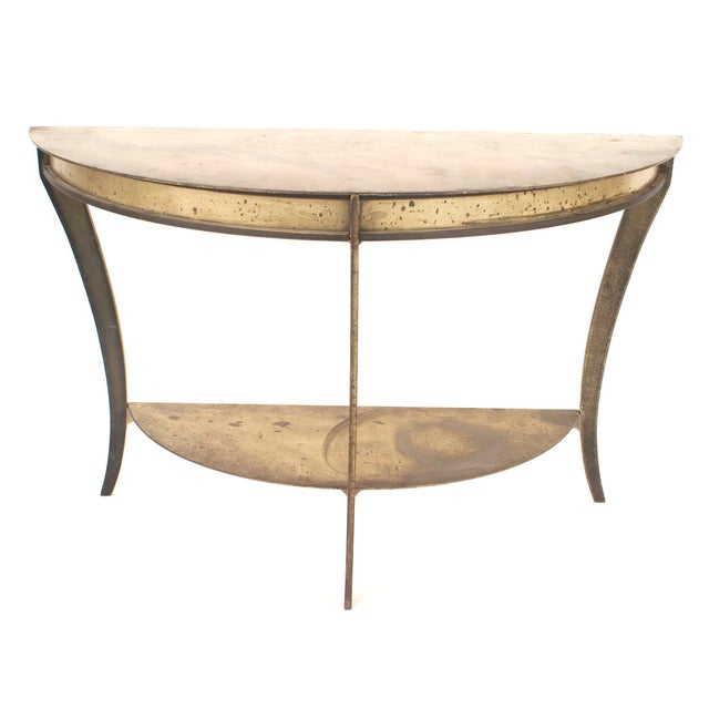 "Pair of American midcentury brass and steel ""D"" shaped demilune console tables with a shelf stretcher."