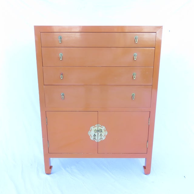 """Vintage 1970s era tall chest in the Chinese style with pulls marked """"Made in Hong Kong."""" This piece is coming from a..."""