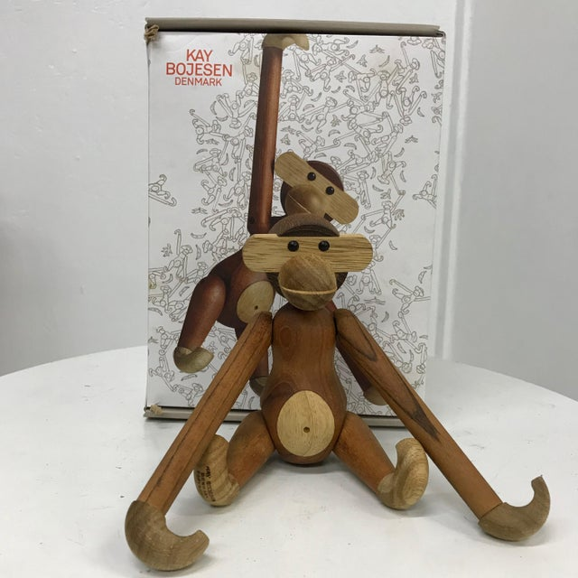 For your consideration, a monkey toy by Kay Bojensen, Made in Denmark Satin teak and ebony, circa 2000. Original package....