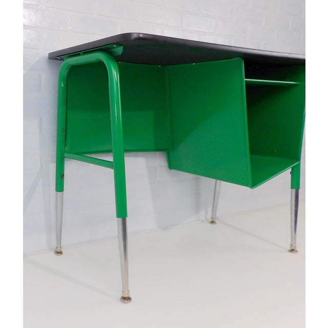 Great petite size. Freshly painted a vibrant gloss Kelly Green. Very versatile little desk. Nice option of adjustable...