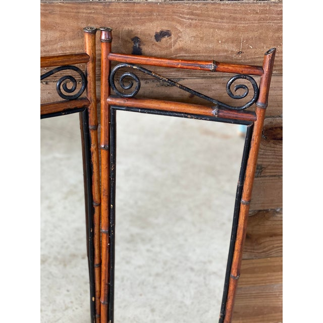 Gorgeous and unique antique French Bi-Fold bamboo mirror in as found antique condition. Unique piece that can be mounted...