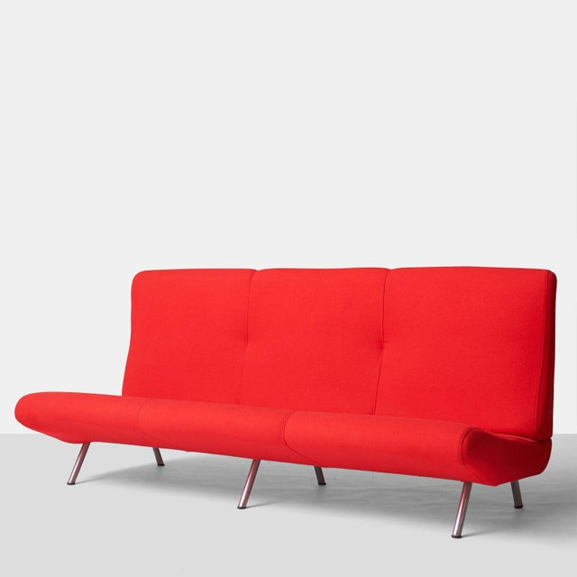 A three-seat sofa by Marco Zanuso for Arflex, in cherry red wool. Features an armless, low seat, high back, and matte-...