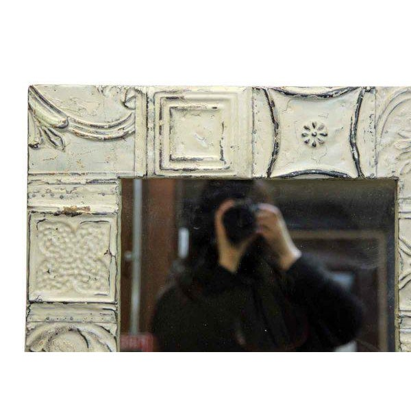 Interactive cream color mirror. This mirror is hand crafted using antique tin ceiling tiles. The style of tin varies per...