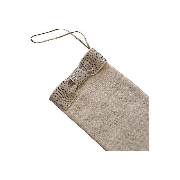 Handloomed Christmas stocking decorated with beaded velvet ribbon. Made with antique fabric.