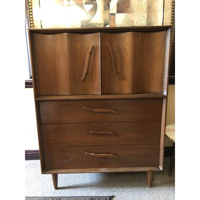 This is a beautiful highboy dresser from the 1950s. The piece maintains its original hardware and drawers. Two matching...