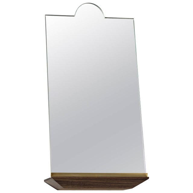 With the propped mirror we removed the restraints of the traditional frame allowing the mirror to move unencumbered. Each...