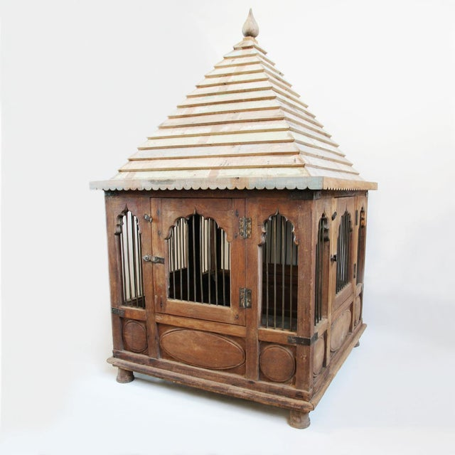 An Indian chicken temple with original patina and iron bars. This is a gorgeous piece that will add tons of character to...