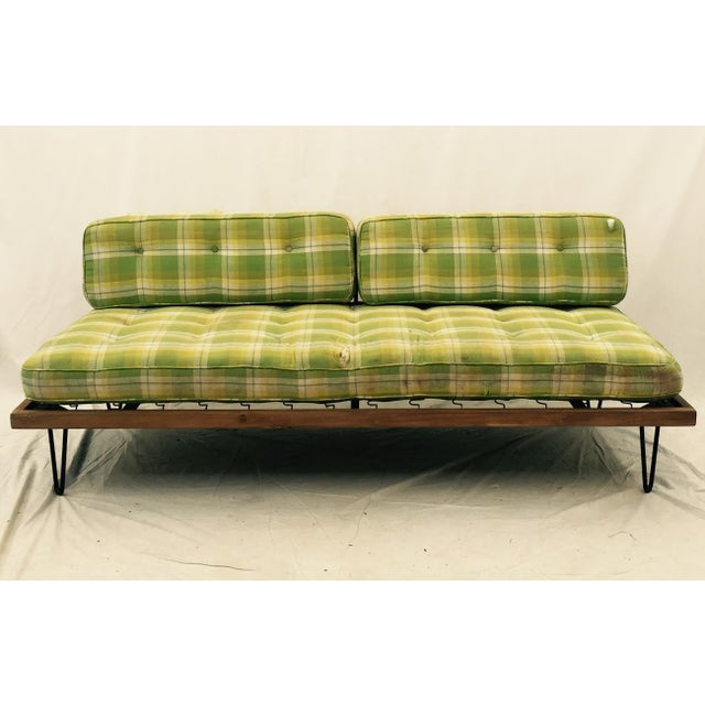 Vintage Mid-century Modern wooden daybed sofa with black metal hairpin legs. Upholstered in original fabric, green madras...