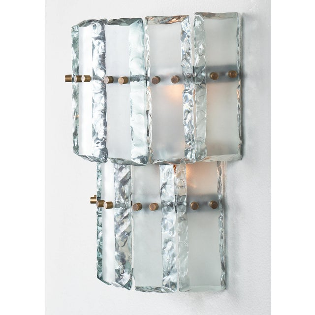 This incredible pair of sconces are made of chunky crystal like slabs of vintage Murano glass made for Fontana Arte, circa...