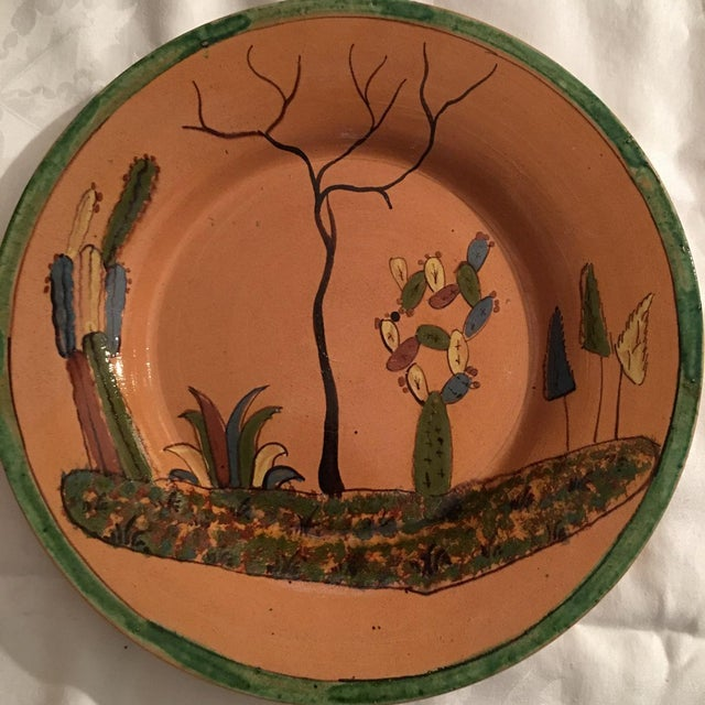 Early vintage Mexican Tlaquepaque ceramic pottery charger or large plate. The piece was made in Tlaquepaque, Jalisco,...