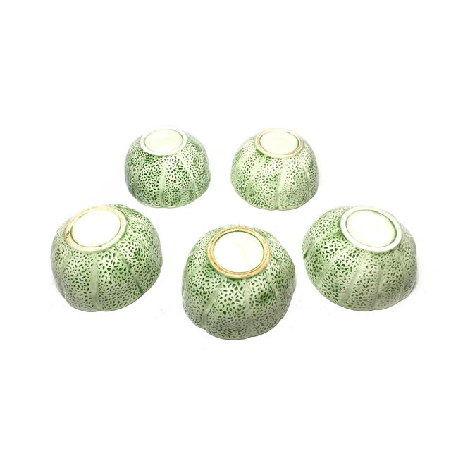 Vintage mid century set of 5 cantaloupe ceramic bowls. Inspired by the melon, these charming bowls have a pale green,...