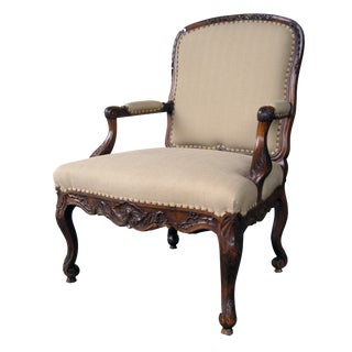 A Curvaceous Danish Rococo Style Carved Walnut Open Armchair For Sale