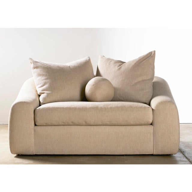 Casually overstuffed down loveseat by Kreiss Collection. Reminiscent of a Michael Taylor design from the 1980s. Extremely...