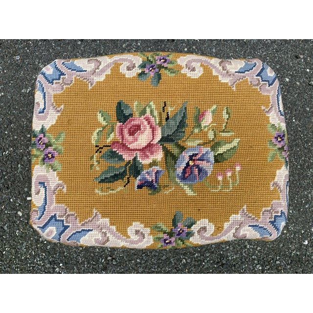 Lovely needlepoint footstool. Giltwood base. Floral design.