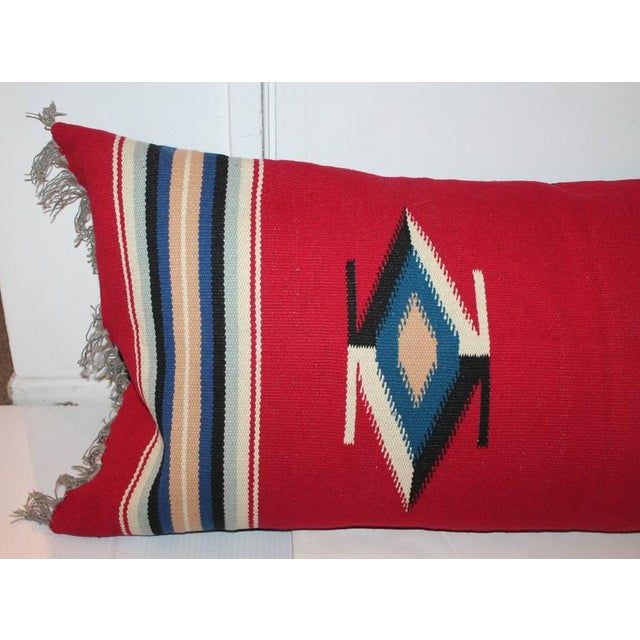 This handwoven large Mexican / American Indian weaving serape bolster pillow with the original fringe. The backing is in...