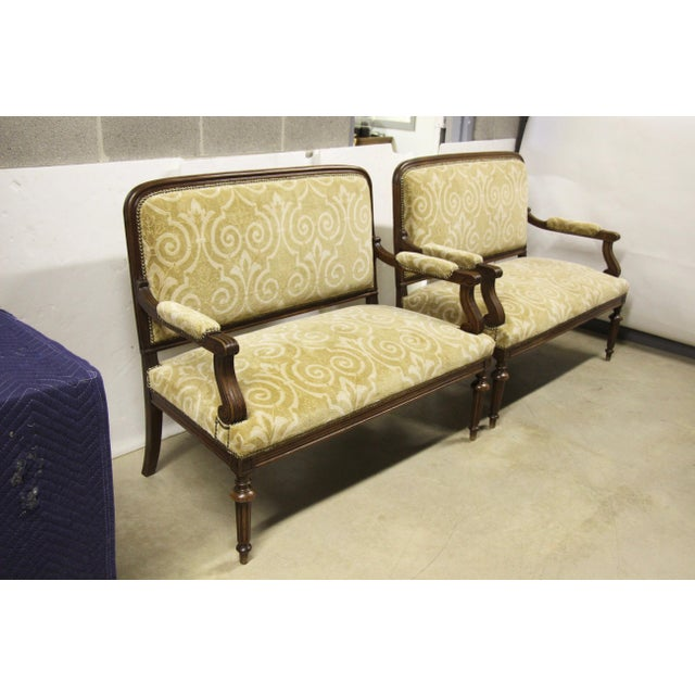Lovely pair of antique French settee benches, Circa 1900. Carved walnut wood, newly upholstered in a gold brocade cut...