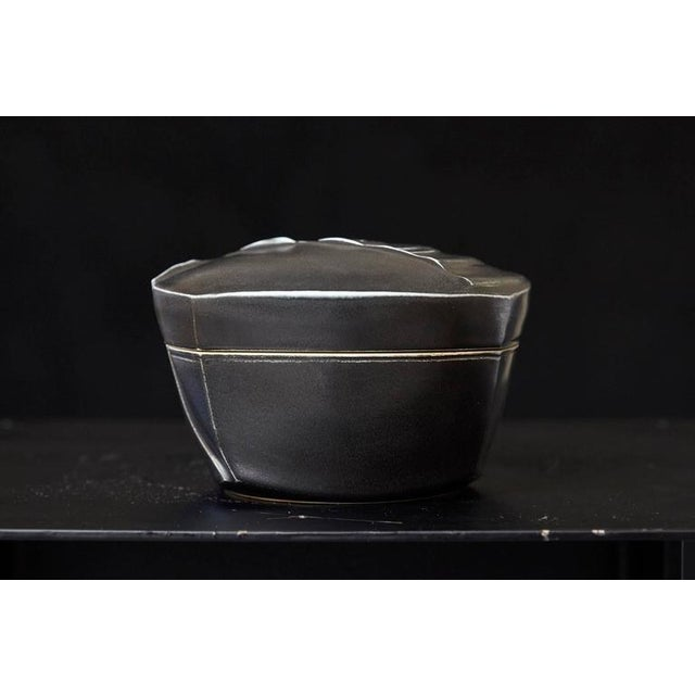 Beautiful thrown and hand built lidded jar with irregular combed shapes and finished in a black glaze. Excellent...