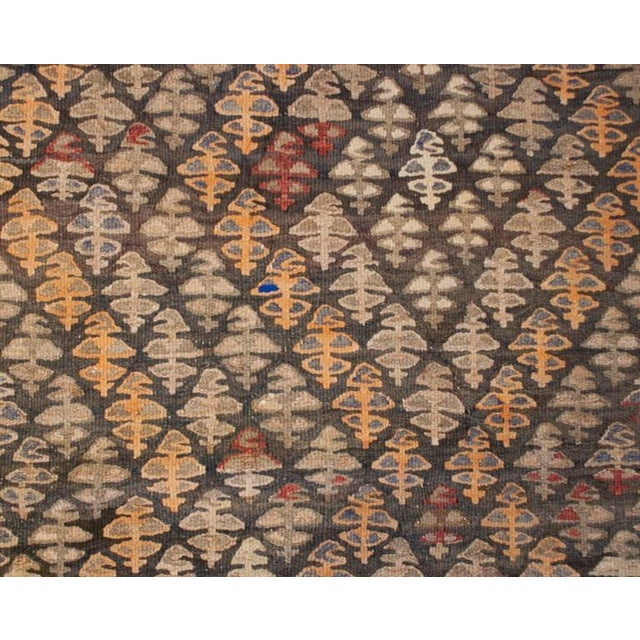 An early 20th century Persian Qazvin Kilim runner with a beautiful all-over tree-of-life pattern, with a subtle zigzag...