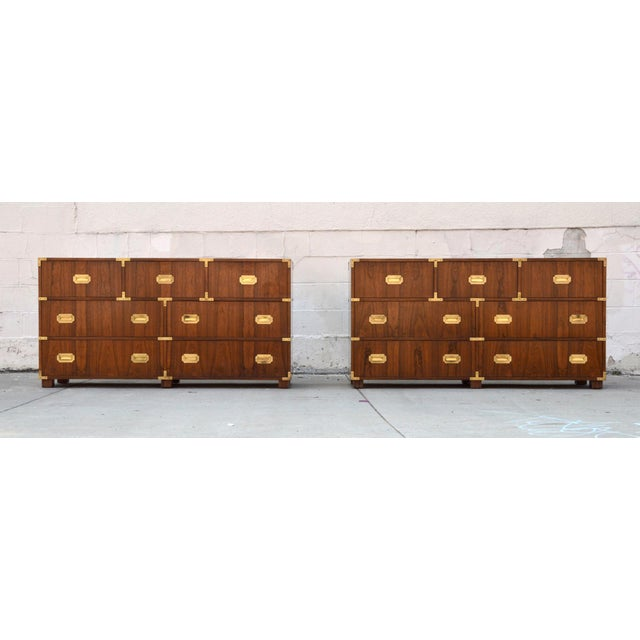 This pair of Campaign style baker chests of drawers each have 7 drawers and are made from bookmatched walnut with brass...
