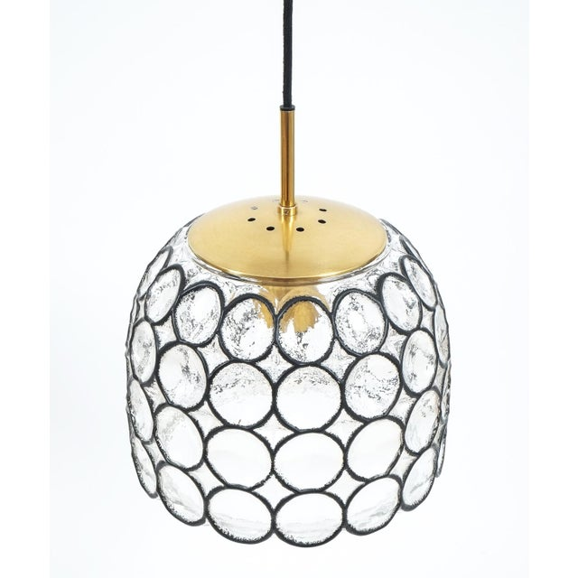 Beautiful pair of 'iron' and glass bell-shaped pendants by Limburg, Germany. The fixtures feature a concave thick clear...