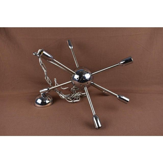 Fantastic vintage 1960's sputnik chrome chandelier with 8 lights and 40 stemmed chrome balls. The main chandelier and...