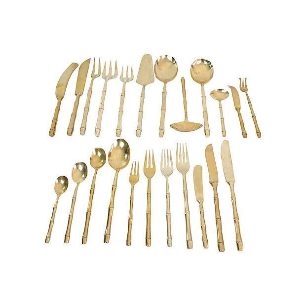 1960's bronze bamboo flatware set. Includes 11-piece flatware set service for 8 with 12 additional serving pieces, total...